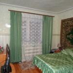 Спальная комната в кирпичном доме